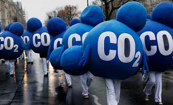 Environmental activists dressed up as CO